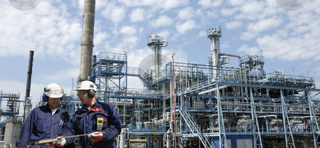 Chemical worker and oil installation stock photo, chemical engineers, workers, with large oil, gas and fuel industry in background, panoramic view by lagereek
