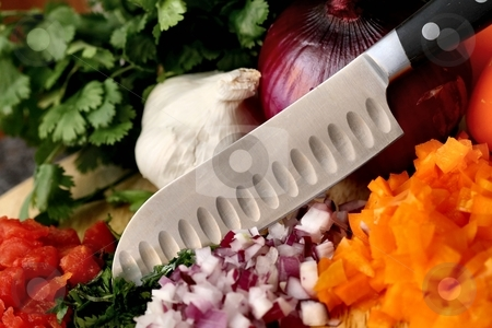 Preparation stock photo, A knife chopping, dicing fresh vegetables by Karma Shuford