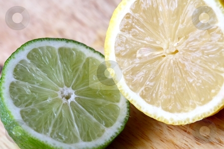 Lime and Lemon stock photo, Fresh citrus fruit by Karma Shuford