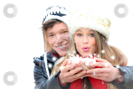 Fantasy happy winter couple blowing a christmas wish stock photo, happy winter couple blowing greetings wishes with snow flakes by mandygodbehear