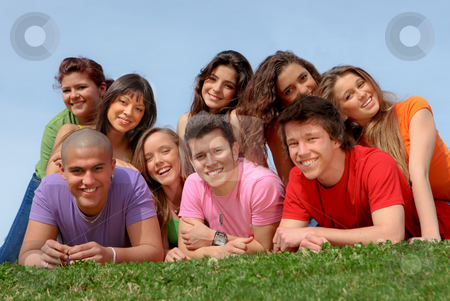 Group of happy smiling diverse teenagers friends stock photo, Group of happy smiling diverse teenagers friends by mandygodbehear
