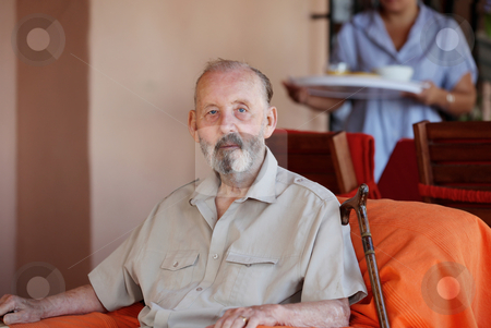 Senior man being brought meal in residential care home stock photo, senior man being brought meal in residential care home by mandygodbehear