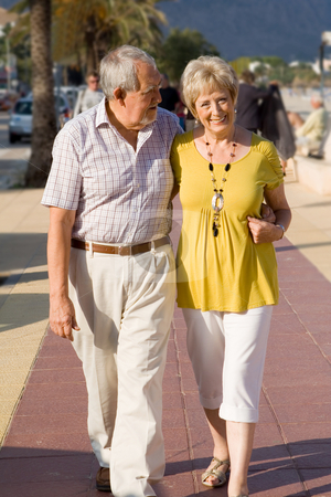 Active seniors walking on vacation in mallorca stock photo, active seniors walking on vacation in mallorca by mandygodbehear