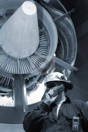 Flight mechanic and jet engine stock photo, mechanic servicing large jumbo-jet engine by lagereek