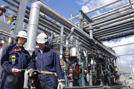Engineering, oil and gas power installation stock photo, oil-workers, engineers, at the main pipeline station inside an oil and gas industry by lagereek