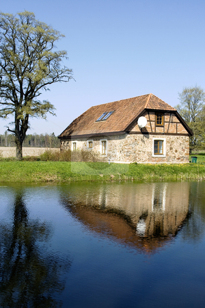Rural landscape stock photo, Rural stone cottage ashore lake in Latvia by Tatjana Keisa