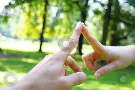 Love stock photo, love concept with hands fingers and copyspace in nature by Gunnar Pippel
