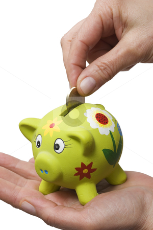 Coin in a piggy bank stock photo, coin in a piggy bank by ambrophoto