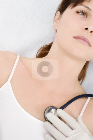 Doctor visits a young caucasian woman with stethoscope stock photo, doctor visits a young caucasian woman with stethoscope by ambrophoto