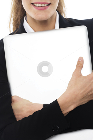 Young businesswoman with laptop in arms on white background studio stock photo, young businesswoman with laptop in arms on white background studio by ambrophoto
