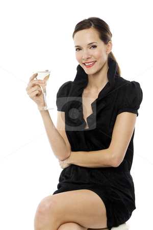 Elegant young woman drinking a cocktail on white background studio stock photo, elegant young woman drinking a cocktail on white background studio by ambrophoto