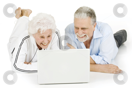 Elderly couple using laptop stock photo, elderly couple using laptop by ambrophoto