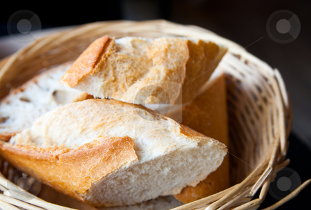 Bread in basket stock photo, bread in basket - little roll breads in basket on table by ilolab