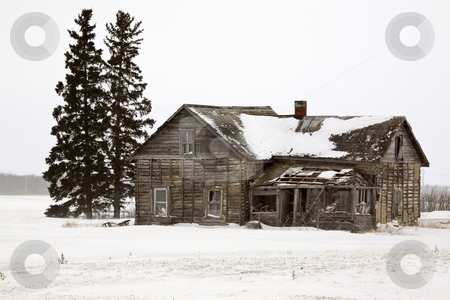 Abandoned farm house in winter stock photo, Abandoned farm house in winter by Mark Duffy