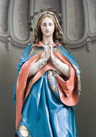 Sculpture of Mary. stock photo, Small sculpture of Mary praying. by exvivo