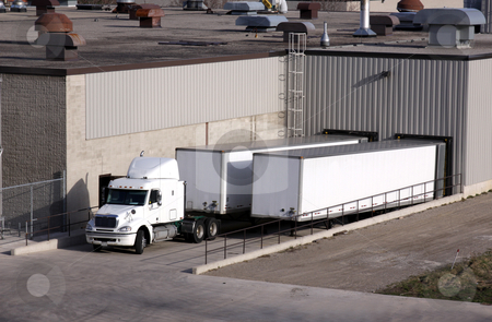 Truck Loading Dock stock photo, A transport truck getting loaded at a loading dock. by Chris Hill