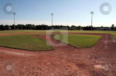 The Diamond stock photo, A view of a baseball diamond at dusk. by Chris Hill