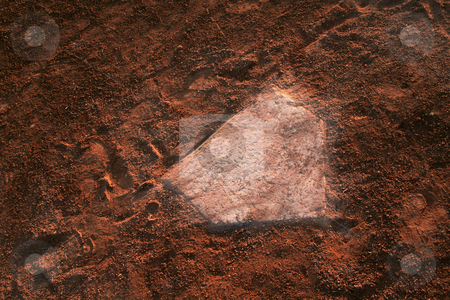 Home Base stock photo, A closeup of a battered home plate at a baseball diamond.  by Chris Hill