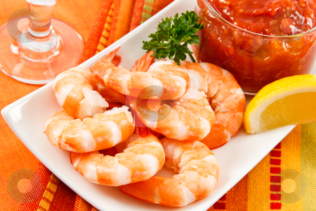 Festive Shrimp Cocktail stock photo, Fresh shrimp are a delicious gourmet appetizer and a dangerous food allergen. by Karen Sarraga