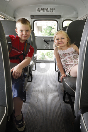 Children sitting in a school bus stock photo, Photo of two happy children sitting in a school bus. by © Ron Sumners