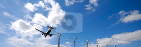 Plane near airport stock photo, Plane is going to land in an airport 1:3 by Lars Christensen