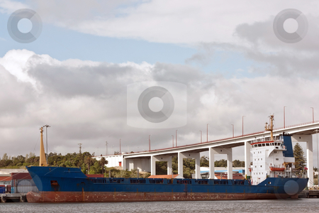 Anchored Freighter stock photo, Anchored Freighter on portuguese shipyard against bridge and sky by Paulo M.F. Pires