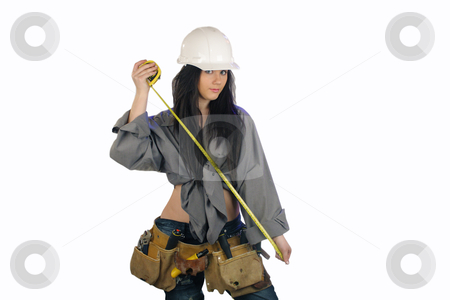 Beautiful Teen Construction Worker (2) stock photo, A lovely young teenage girl wearing a white hardhat and a well-worn toolbelt. by Carl Stewart