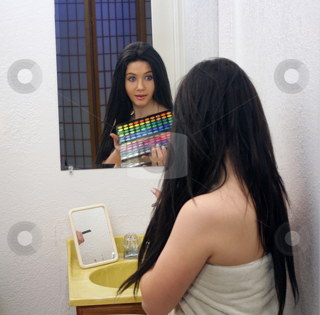 Beautiful Teen Girl with Makeup Palette (1) stock photo, A lovely teenage girl sits in front of her mirror with her makeup palette and a surprised or amazed facial expression. by Carl Stewart