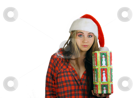 Teen Girl Santa's Helper (3) stock photo, A beautiful teenage girl wearing a Santa's helper hat and a comfy flannel nightgown, with a blank, bored, or irritated facial expression, holds a wrapped gift.  Plenty of room on frame left for inserting text, graphics, etc.  White background. by Carl Stewart