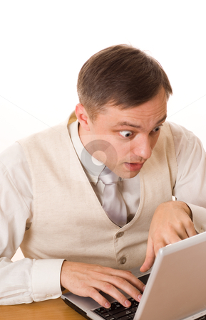 Man working with laptop on white background stock photo, young businessman working with laptop on white by Alevtina Guzova