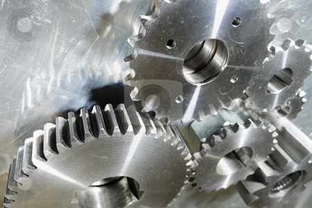 Titanium and steel power stock photo, titanium gears mirrored in steel backdrop by lagereek