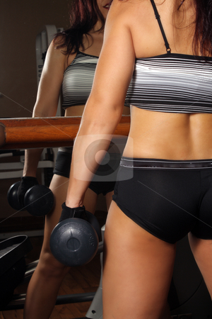 Athletic Female Torso, close-up, rear view stock photo, A close-up shot of the torso of a female dressed in fitness wear, holding a hand weight, her back to the camera. by Carl Stewart