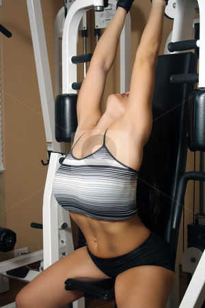 Lovely Athletic Female Working Out (9) stock photo, An attractive middle-age female works out on a weight machine. by Carl Stewart