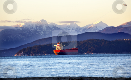 Vancouver Harbor Freighter Lighthouse Snow Mountains Sunset Brit stock photo, Vancouver Harbor Freighter Lighthouse From Jericho Beach Snow Mountains Sunset British Columbia Pacific Northwest by William Perry