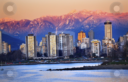 Vancouver Skyline Harbor English Bay Snow Mountains Sunset Briti stock photo, Vancouver Skyline Harbor High Rises Sailboat English Bay From Jericho Beach Snow Mountains Sunset British Columbia Pacific Northwest by William Perry