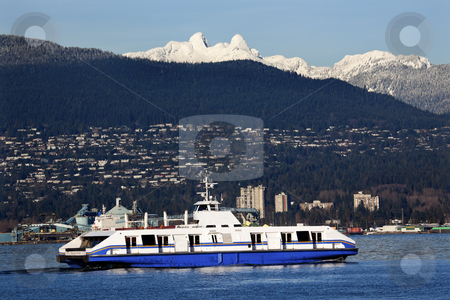 Vancouver Harbor Ferry Snowy Two Lions Mountains British Columbi stock photo, Vancouver Harbor Ferry Freighter Snowy Two Lions Snow Mountains British Columbia Pacific Northwest by William Perry
