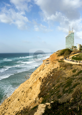 Sea coast and the view on Natania stock photo, Sea coast and panorama of new modern hotel in Natania, Israel by Tatjana Keisa