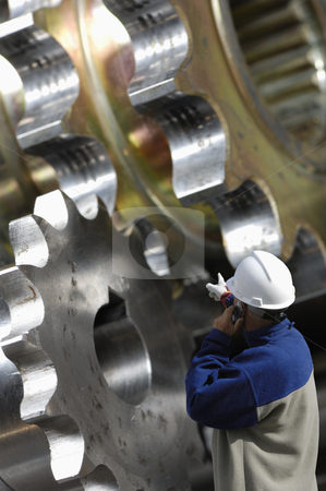 Engineer and steel works stock photo, engineer examining large gear machinery, metal industry works by lagereek
