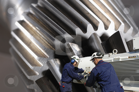 Steel and metal engineering stock photo, engineers, working with large gear wheels machinery, titanium and steel works by lagereek