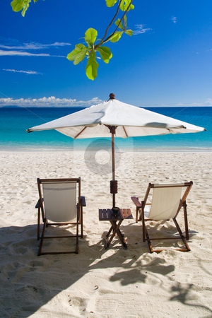 Deckchairs on the beach stock photo, Deckchairs on the beach in front of the lagoon by Pierre-Yves Babelon