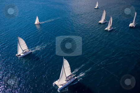 Regatta in indian ocean stock photo, Regatta in indian ocean, sailboat and catamaran. Helicopter view by Pierre-Yves Babelon