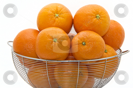 Delicious Florida oranges stock photo, Delicious ripe Florida oranges stacked up on a white plate by derejeb