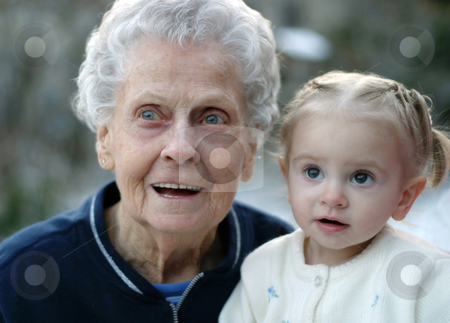 Wide Eyed with Great Great Grandma stock photo, Toddler and her great great grandmother share a moment of wonder by allihays