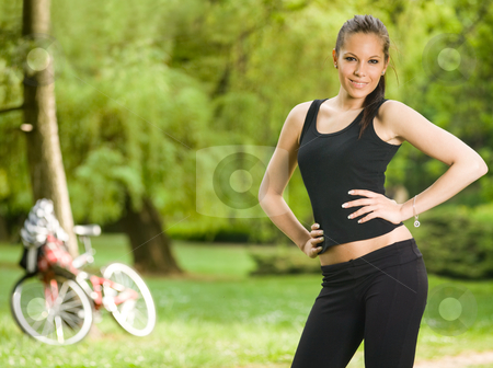 Gorgeous young fitness brunette posing outdoors. stock photo, Gorgeous young slim fitness brunette posing outdoors in nature. by exvivo