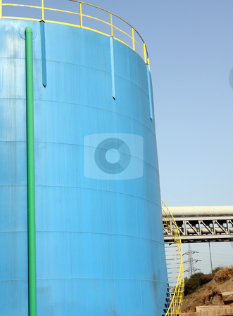 Petrol blue tank stock photo, A big petrol blue tank to deposit gasoline by Roberto Giobbi