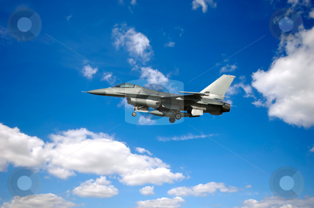 Warplane stock photo, warplane is flying in blu and cloudy sky by Lars Christensen