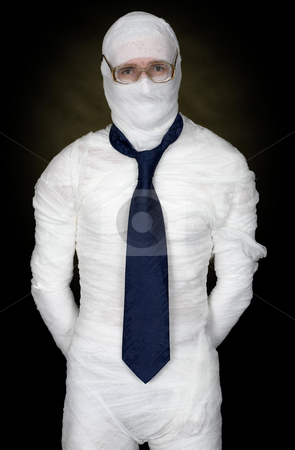 Man in bandage with eyeglasses and  the cravat stock photo, Man in bandage with eyeglasses and  the cravat on black by Alexey Romanov