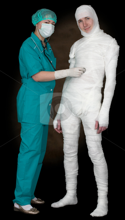 Man in bandage and nurse with stethoscope stock photo, Man in bandage and nurse with stethoscope on black by Alexey Romanov