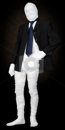 Mummy in jacket and tie stock photo, Mummy in jacket and tie on the black background by Alexey Romanov