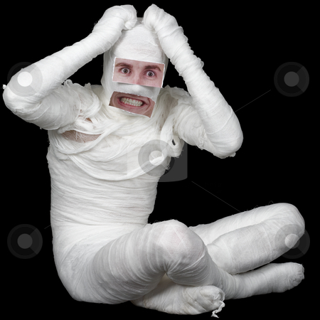 Man in bandage with false eyes and mouth stock photo, Man of bandaged with false eyes and mouth on black by Alexey Romanov